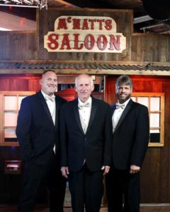 The saloon photo booth with a personalized sign for a local wedding.