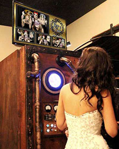 Bride with the steampunk photo booth wedding rental.